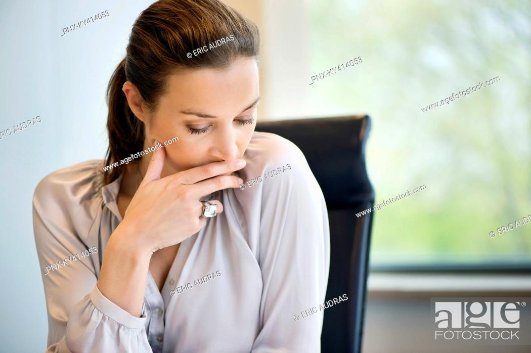 Stock Photo: Close-up of a businesswoman thinking in an office.