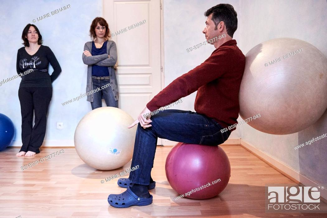Stock Photo: Reportage on a midwife in Lyon, France. Post-partum abdominal and pelvic floor group rehabilitation session. These exercises enable the women to feel their.