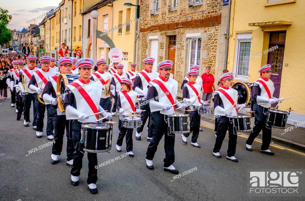 Stock Photo: The town band plays during Bastille Day celebrations in the town of Villaines-la-Juhel, Pays de la Loire, France.