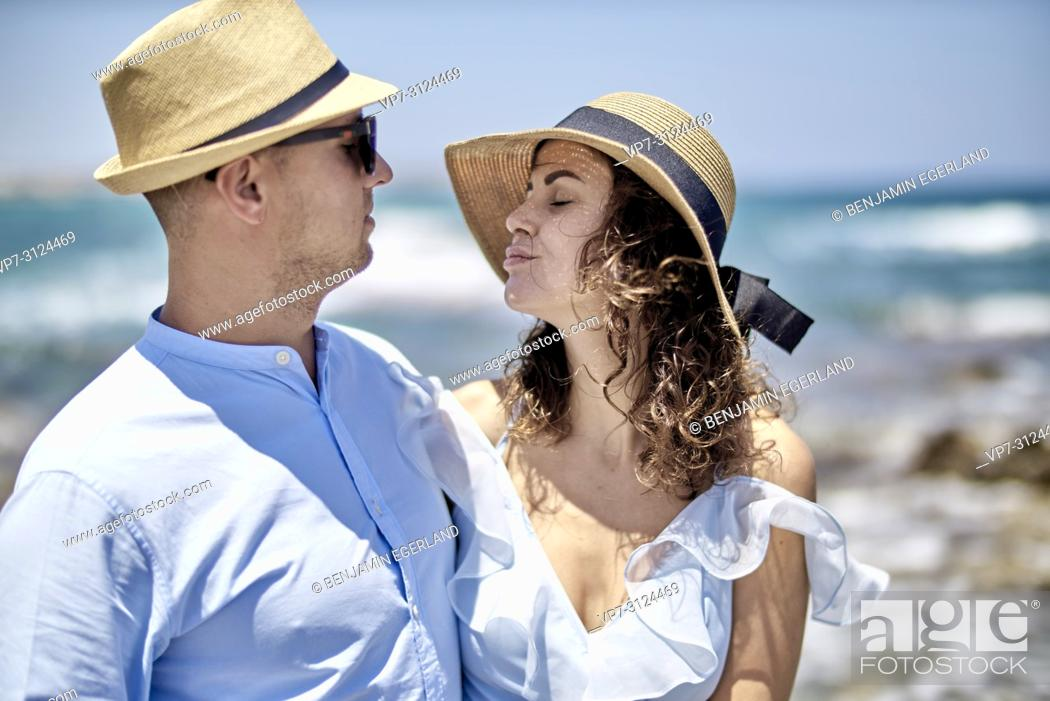 Stock Photo: couple at beach in Hersonisssos, Crete, Greece.