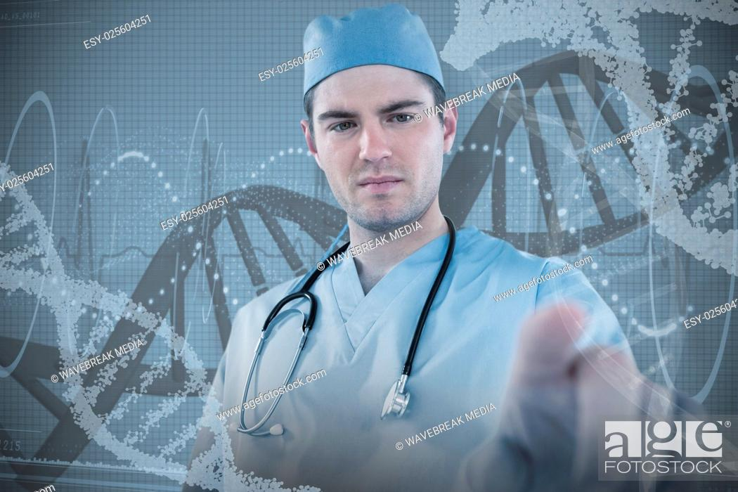 Stock Photo: Composite image of surgeon pretending to be using futuristic digital screen.