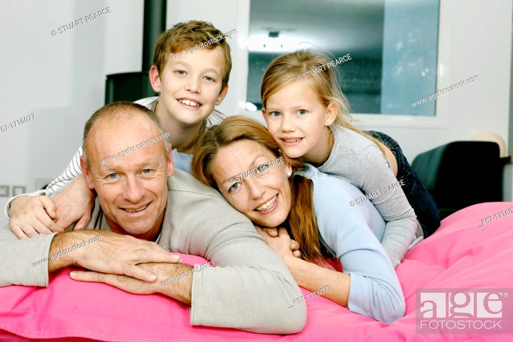 Stock Photo: Portrait of happy family looking at camera.