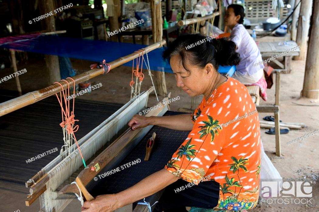 Stock Photo: Thailand, Northeastern Thailand, Isan region, Chonnabot district, woman weaving the mat mii dyeing the threads of silk before weaving.