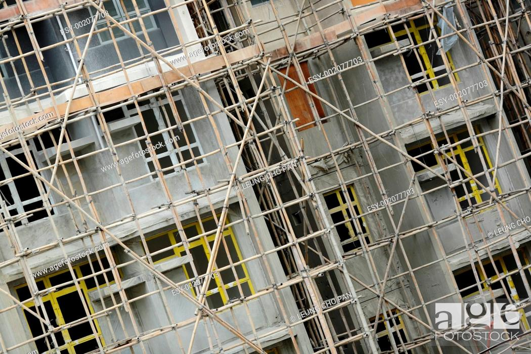 Stock Photo: bamboo scaffolding in construction site.