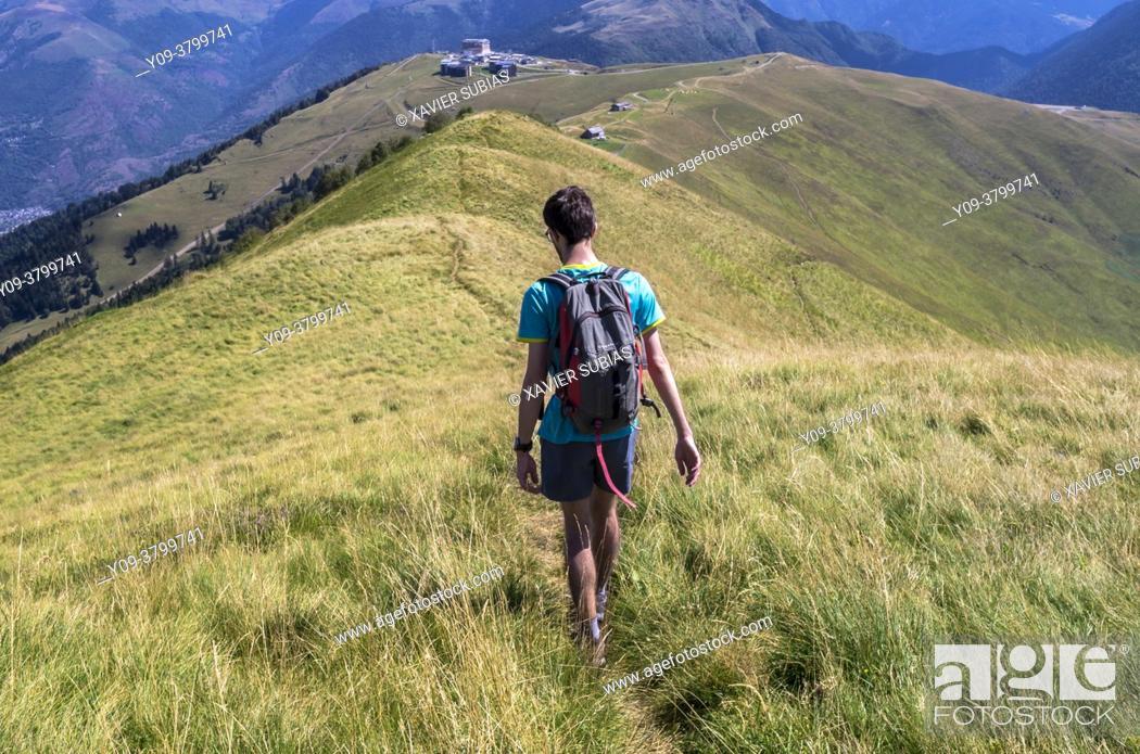 Stock Photo: Hiker, Superbagnères, Bagnères-de-Luchon, Pyrenees, Haute-Garonne department, Occitanie, France.