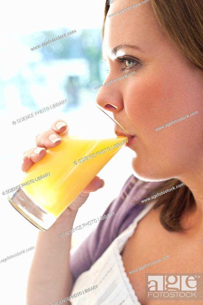 Stock Photo: Woman drinking orange juice.
