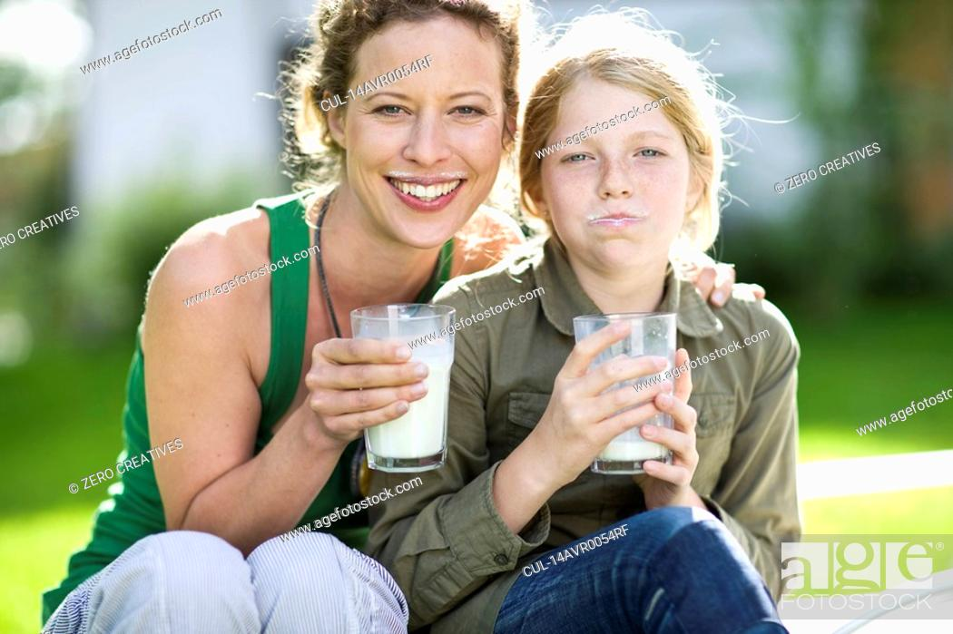 Stock Photo: mother and daughter drinking milk.
