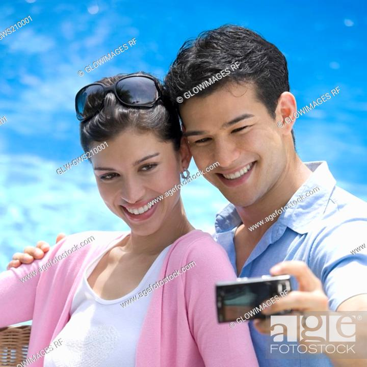 Stock Photo: Close-up of a young couple taking a picture of themselves.