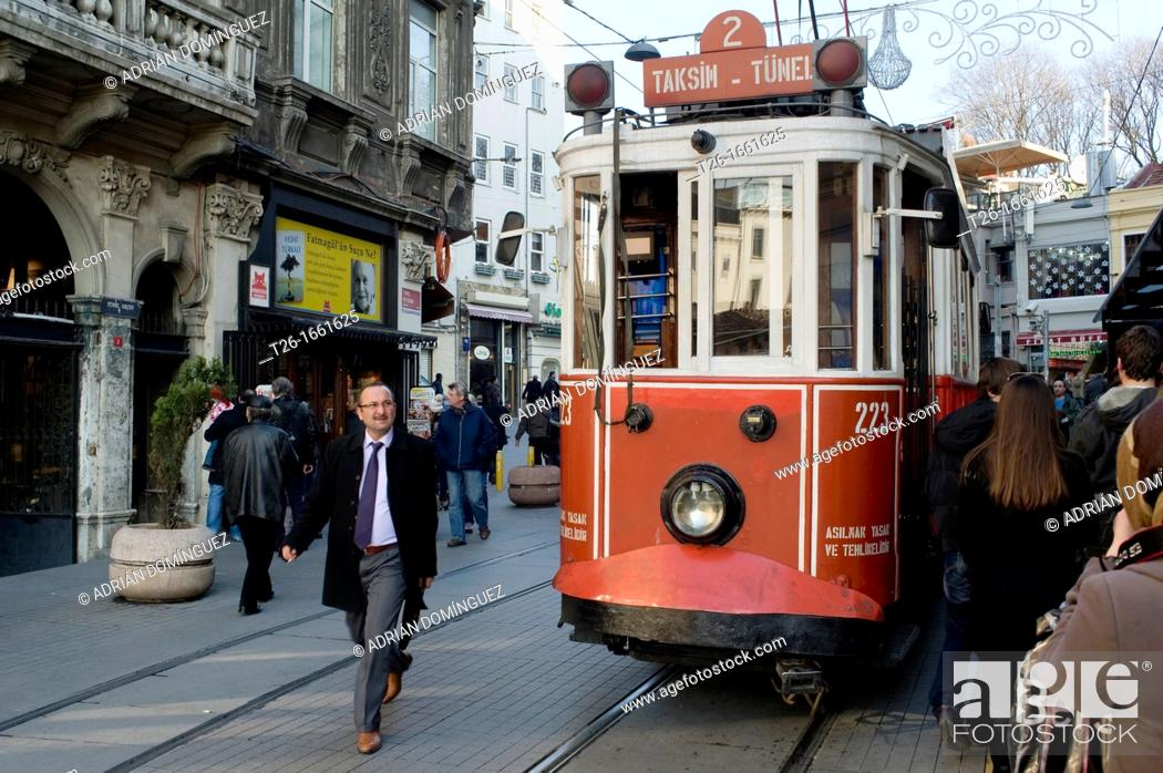 Stock Photo: Man walking near the tramway. City of Istanbul, Turkey.
