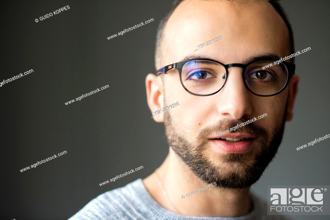 Stock Photo: Tilburg, Netherlands. Enhanced studio shot portrait of Ammar, a Syrian refugee with valit and legal status to build his life in Holland.