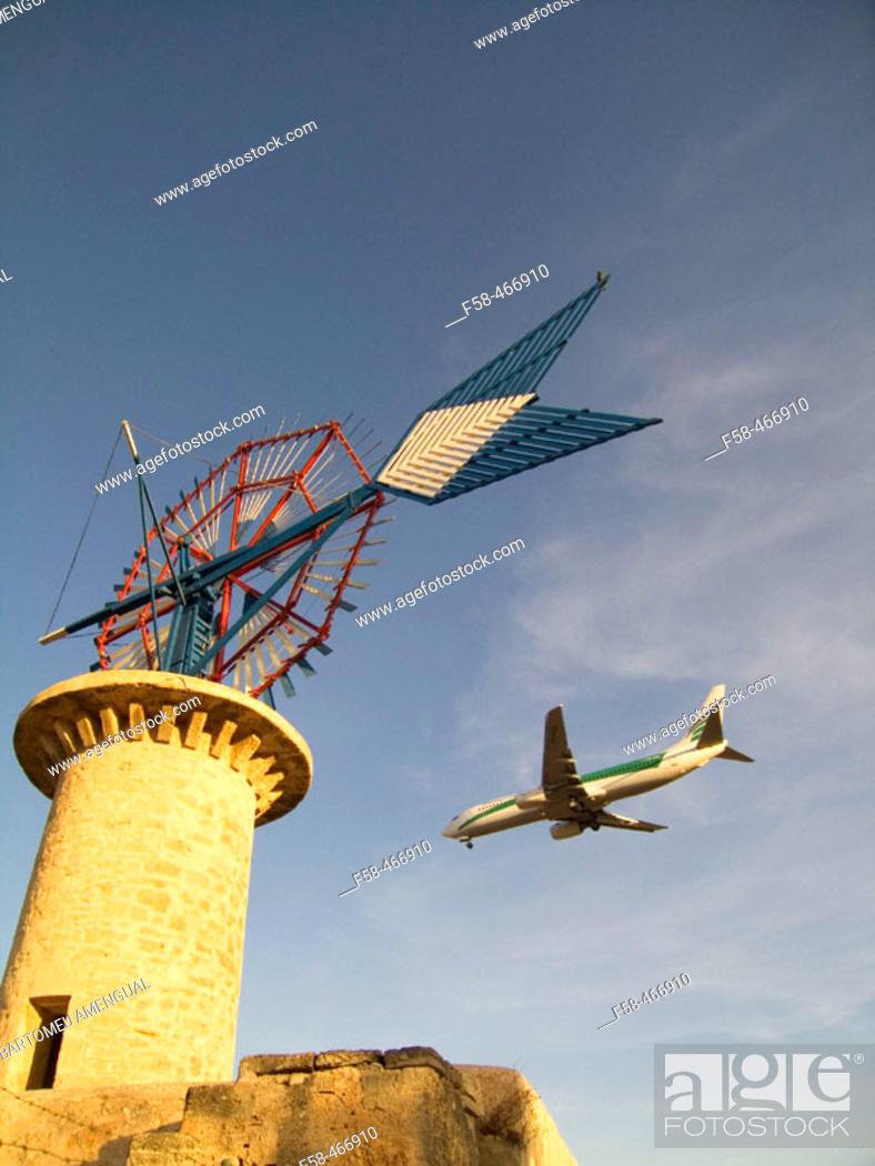 Stock Photo: Windmill and airplane landing. Son Sant Joan airport. Palma de Mallorca. Balearic Islands. Spain.