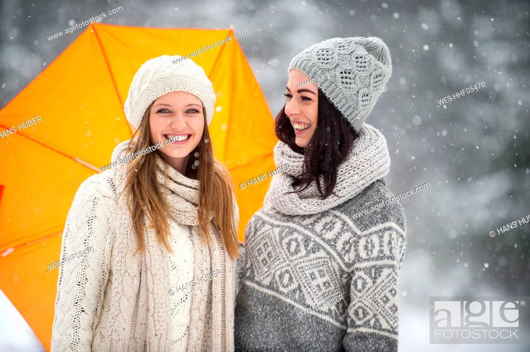 Stock Photo: Two friends wearing knitwear in winter.