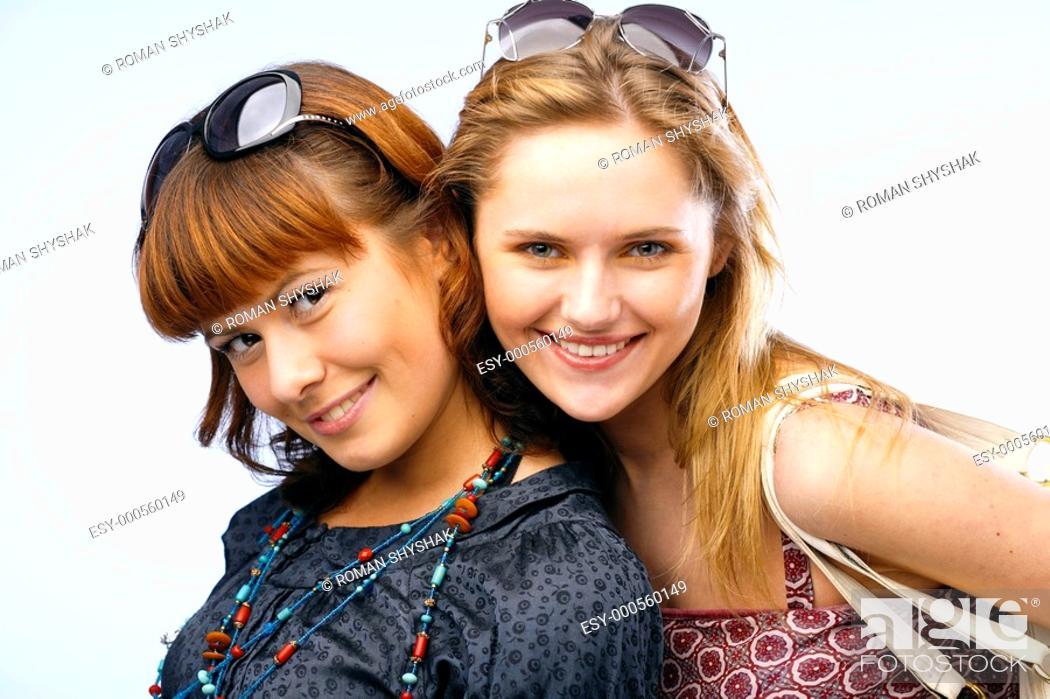Stock Photo: Beautiful young women posing and smiling.