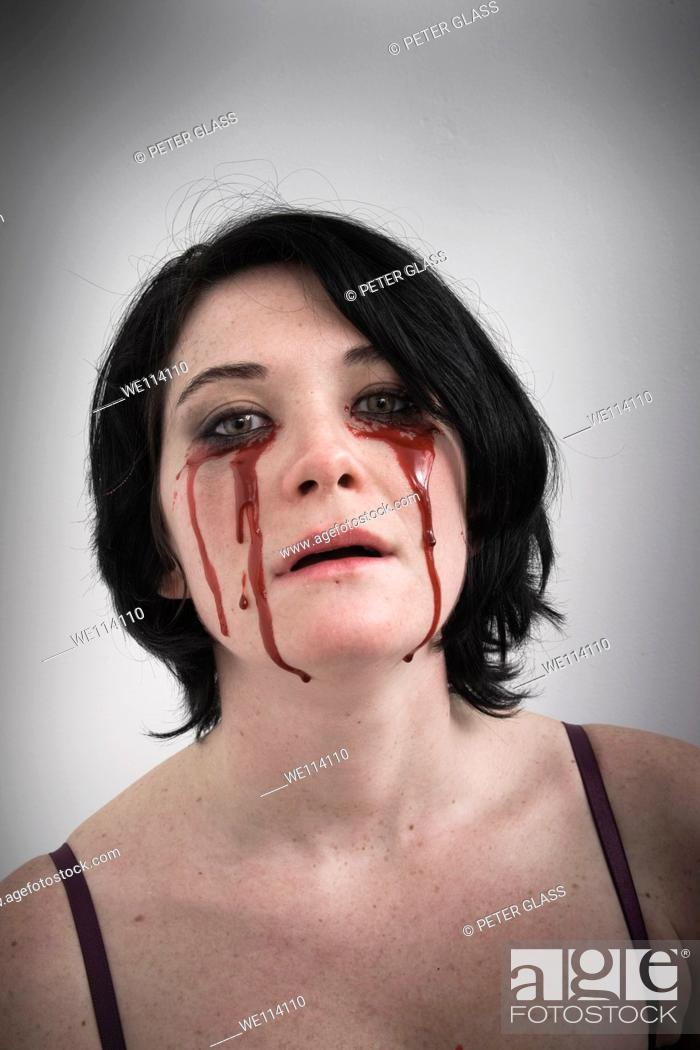 Stock Photo: Woman with blood dripping from under her eyes.