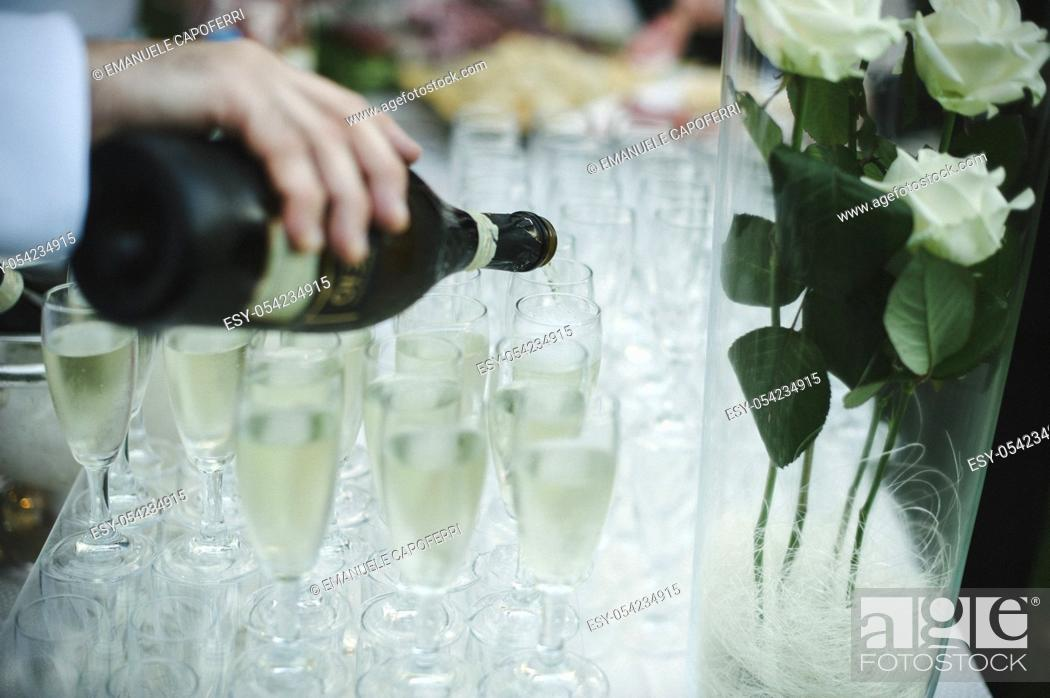 Stock Photo: Waiter serving of sparkling white wine.