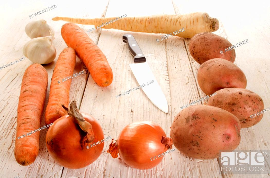 Stock Photo: organic vegetables for preparing a vegetable soup.