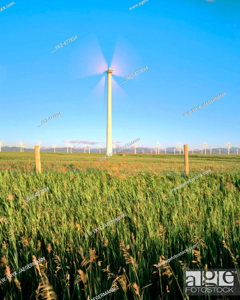 Stock Photo: Wind Turbine and Fence Posts at Sunrise near Pincher Creek, Alberta, Canada.