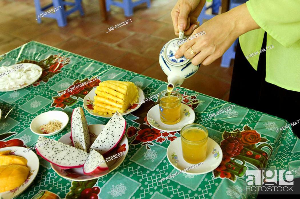 Stock Photo: Vietnam, Mekong-Delta, woman, detail, hands, tea, pours, plates, fruits, Asia, cut open southeast-Asia, people tradition tea-rite tea-pot tea-glasses, pours out.