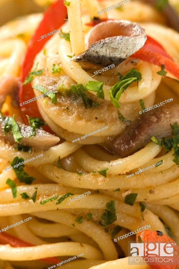 Stock Photo: Spaghetti with anchovies and peppers close-up.