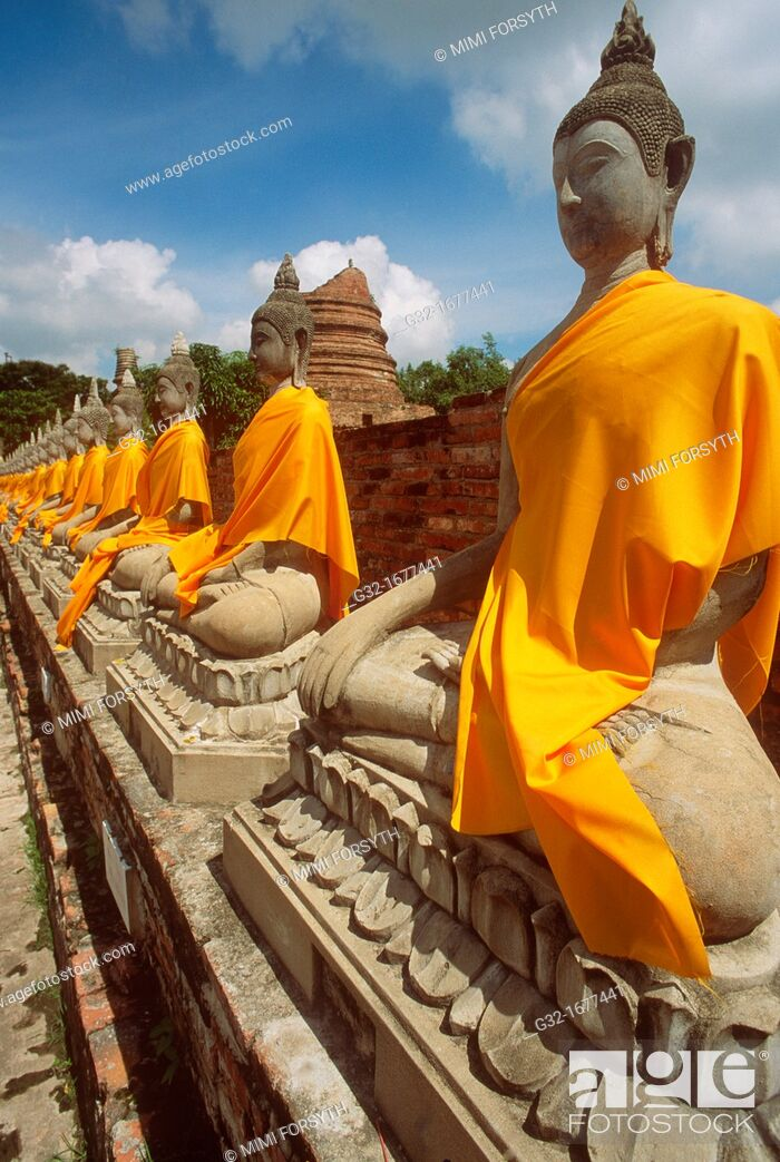 Stock Photo: Buddhas at Ayutthaya, Thailand, wrapped in gold cloth on the occasion of the eve of Buddha's birth.