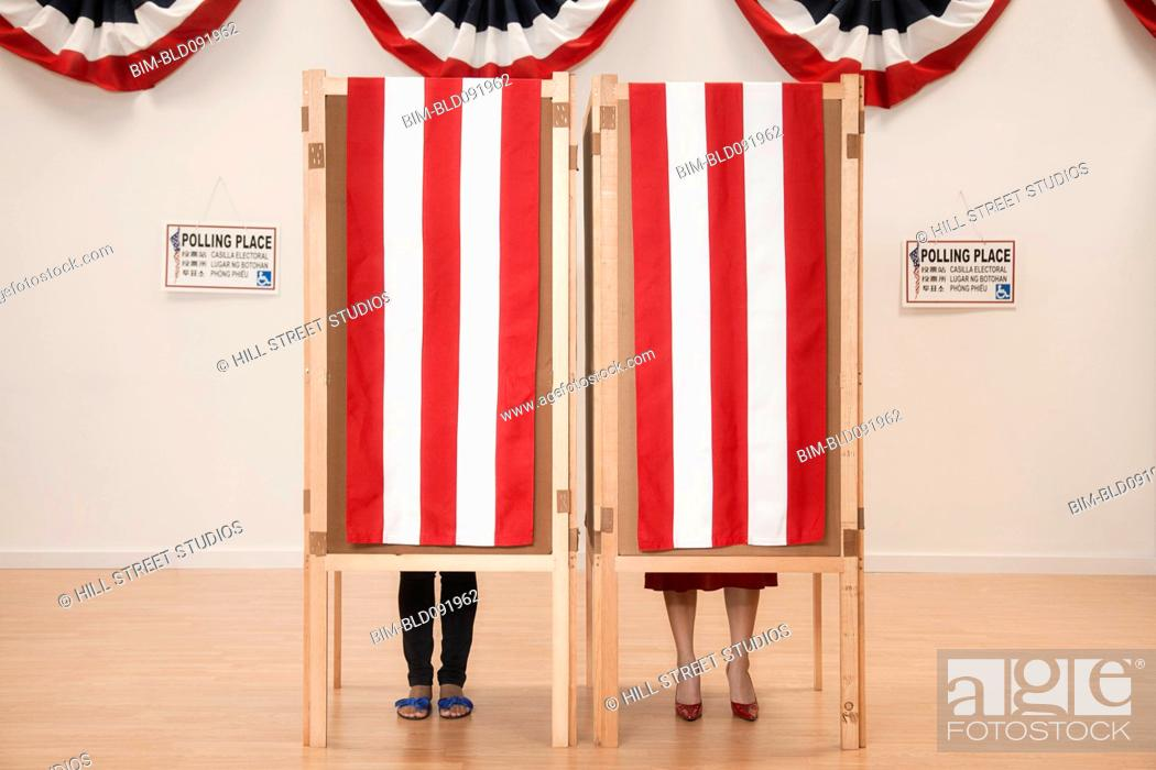 Stock Photo: Voters voting in polling place.