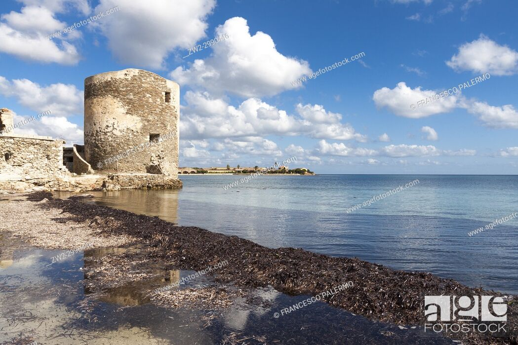 Stock Photo: Scenic view of Saline tower against the scattered clouds at midday. Stintino, Sardinia. Italy.