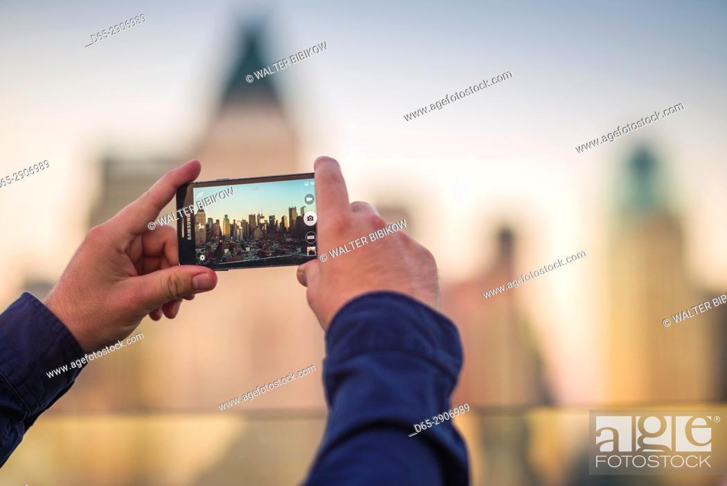 Stock Photo: USA, New York, New York City, Mid-Town Manhattan, cell phone skyline.