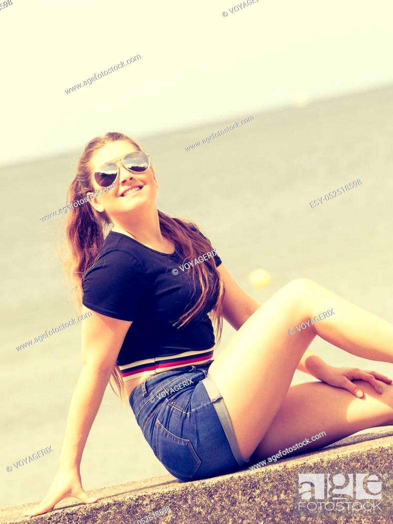 Stock Photo: Happy joyful smiling woman spending her free time outside enjoying beautiful summertime weather.