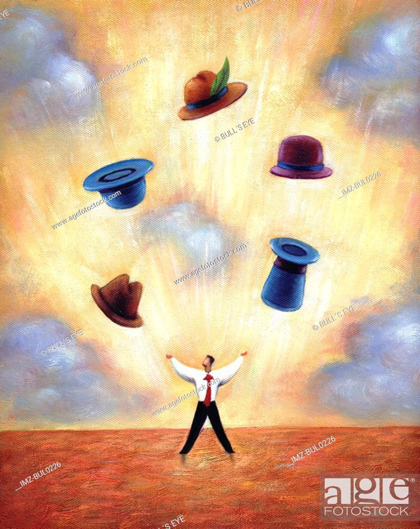 Stock Photo: Businessman juggling different hats.