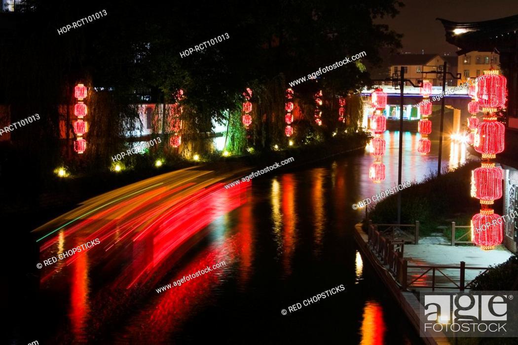 Stock Photo: Reflection of Chinese lanterns in water, Nanjing, Jiangsu Province, China.