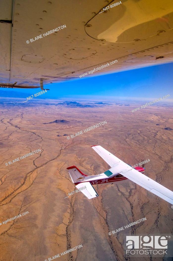 Stock Photo: Two Desert Air Cessna 210's fly above the Namib Desert, Namibia.