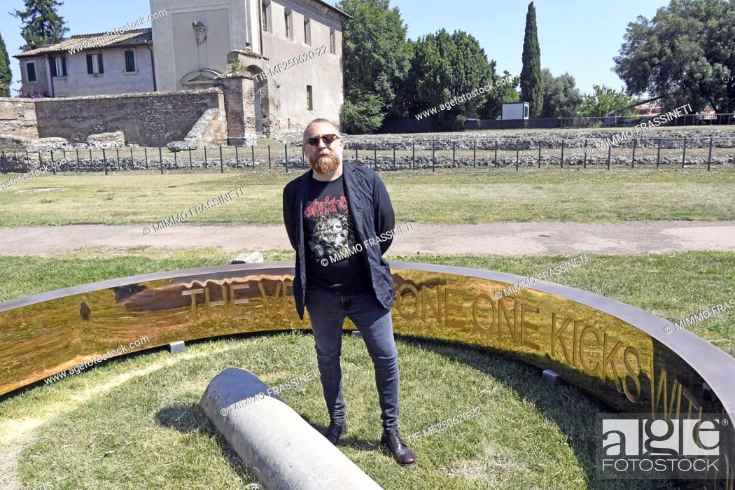 Stock Photo: The artist Francesco Arena during the presentation of his bronze sculpture 'Anello' placed in the Viigna Barberini at the Palatino.