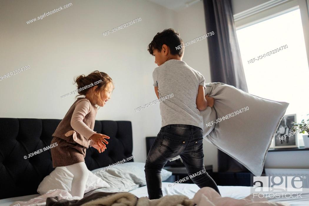 Stock Photo: Kids playing in bedroom.