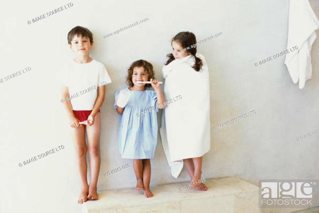 Stock Photo: Kids in the bathroom.
