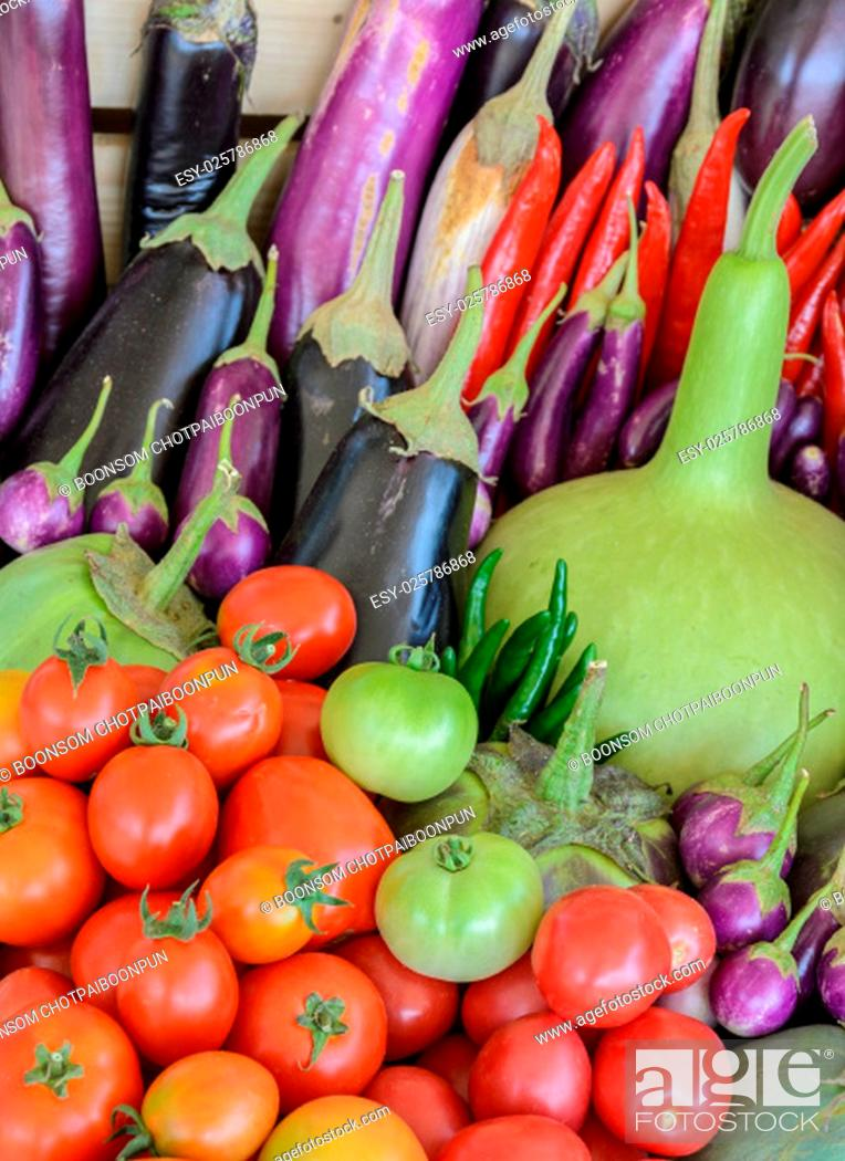 Stock Photo: Assortment of fresh vegetable (purple egg plant, tomato, Thai eggplant, bottle gourd, red hot chili and tomato) in wooden box.
