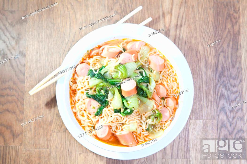 Stock Photo: Instant Noodles with sausage with Pak Choy or Chinese Cabbage in white bowl and Plate on wooden table.