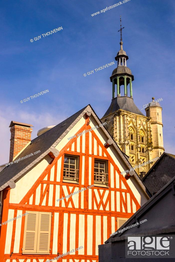 Stock Photo: Medieval half timbered house, and Notre Dame de la Couture steeple basilica , in the backlground, Bernay, 27, Normandy, France.