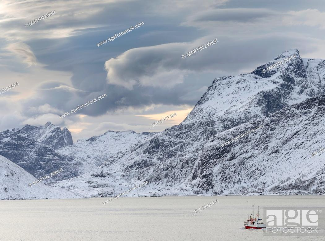 Stock Photo: Mountains of Moskenesoya rising over Selfjorden and Torsfjorden near village Fredvang, seen from Flakstadoya . The Lofoten Islands in northern Norway during.