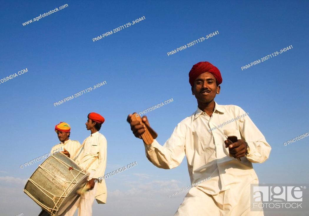 Stock Photo: Three men playing musical instruments, Jaisalmer, Rajasthan, India.