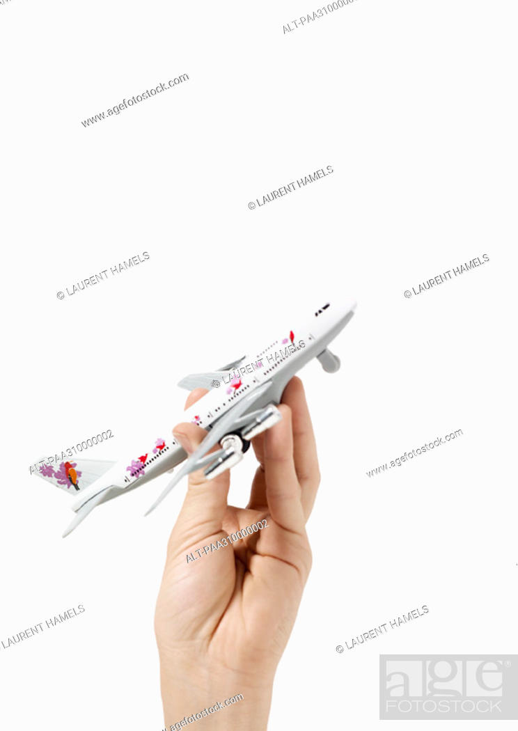 Stock Photo: Hand holding toy airplane.