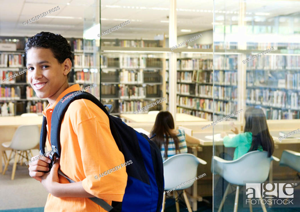 Stock Photo: Teenage boy posing in library.