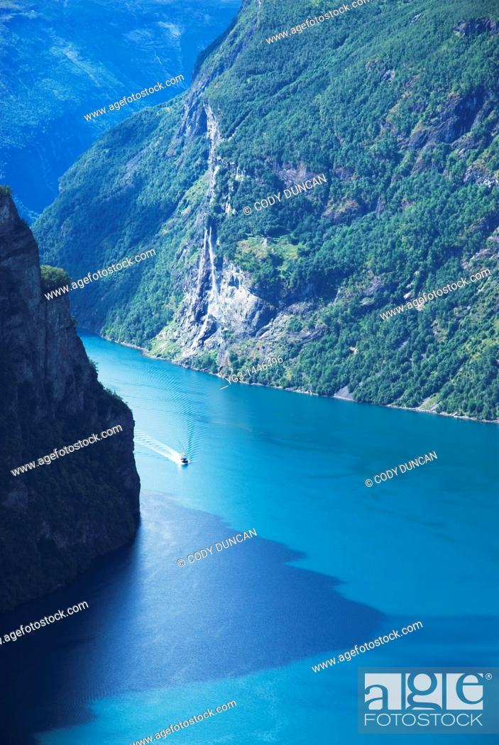 Stock Photo: Small boat in Geiranger Fjord, Norway.