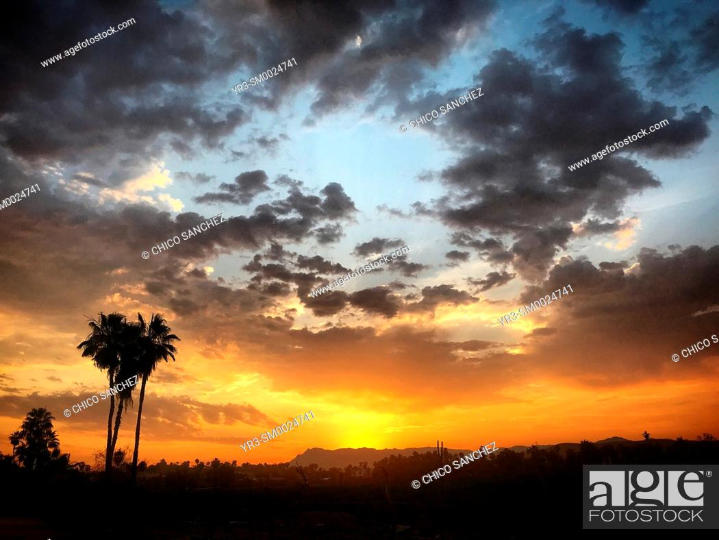 Stock Photo: Sunrise in the beach in the Pacific Ocean coast in Todos Santos, Baja California, Mexico.