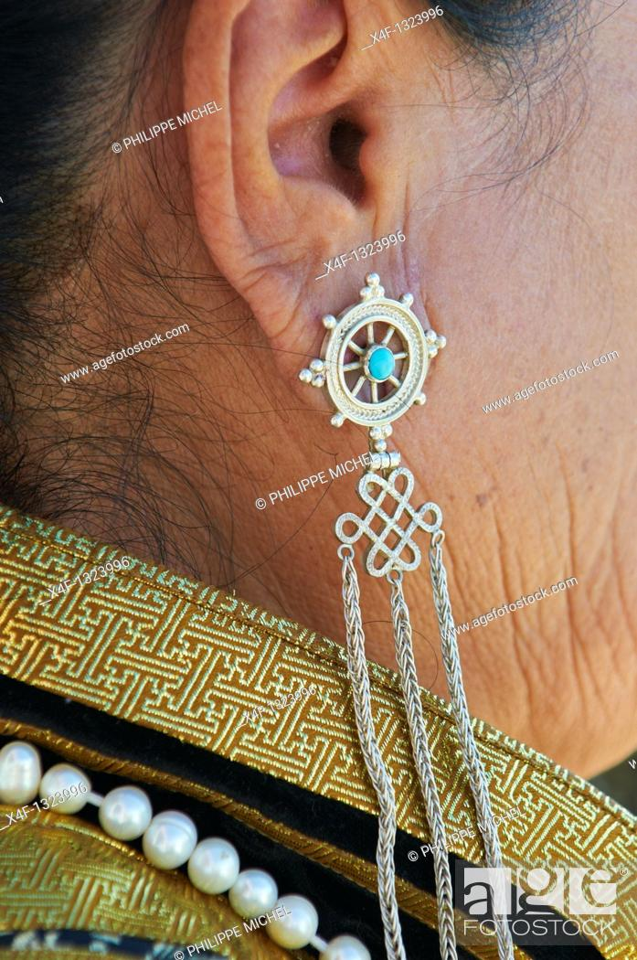 Stock Photo: Mongolia, Arkhangai province, Naadam festival, siver and turquoise earing.