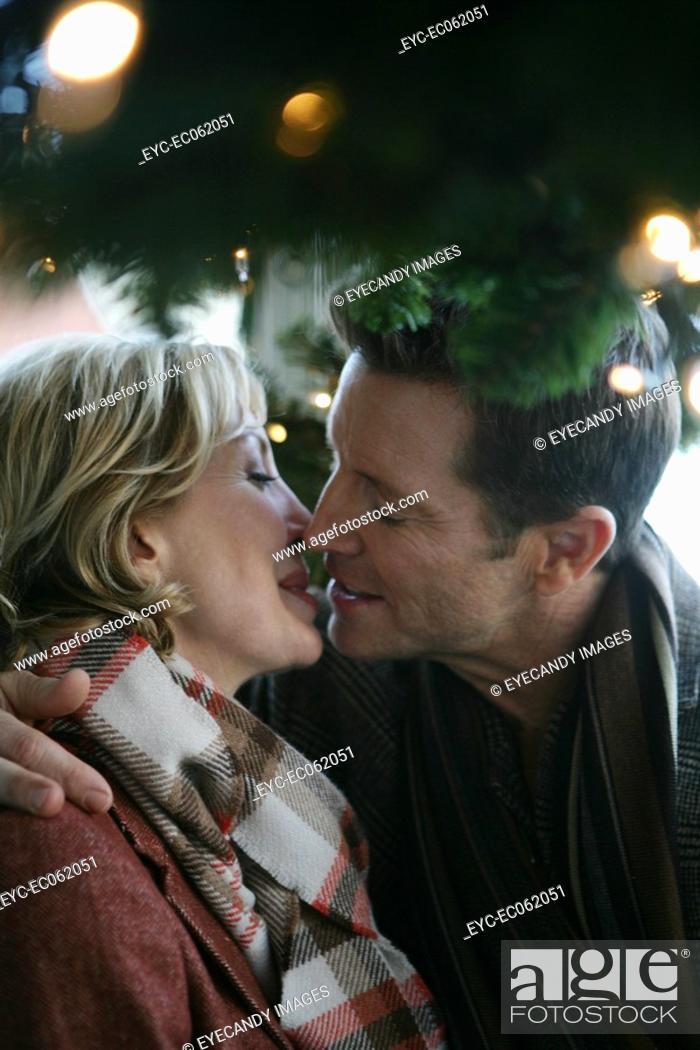 Stock Photo: Mature couple kissing.