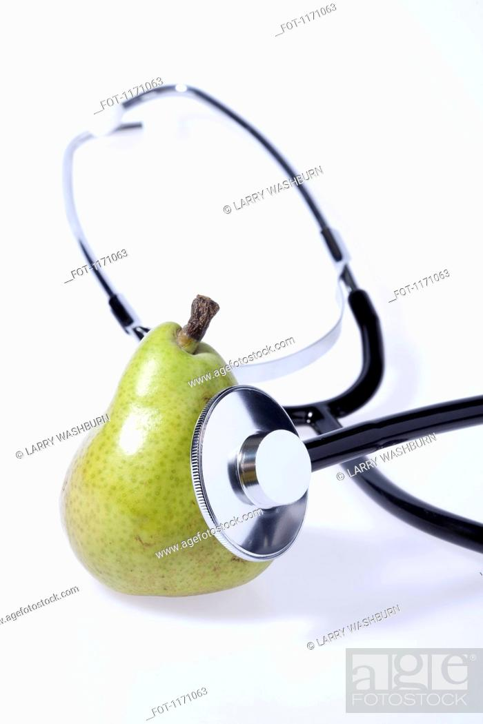 Stock Photo: A stethoscope listening to a pear.