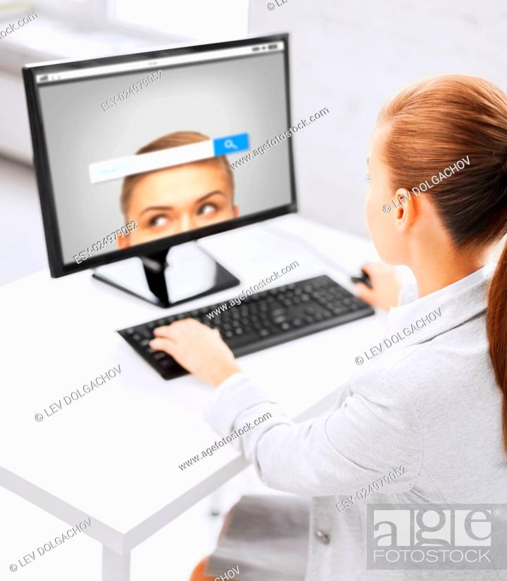 Stock Photo: business, people, technology and education concept - businesswoman or student girl with internet browser search bar on computer screen sitting at office table.