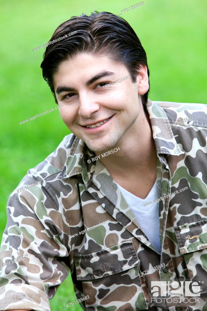 Stock Photo: Portrait of a young man outdoors.