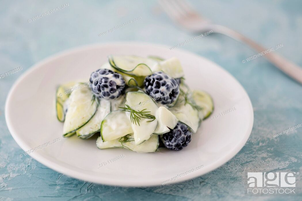 Stock Photo: Cucumber salad with blackberries, yoghurt and dill.