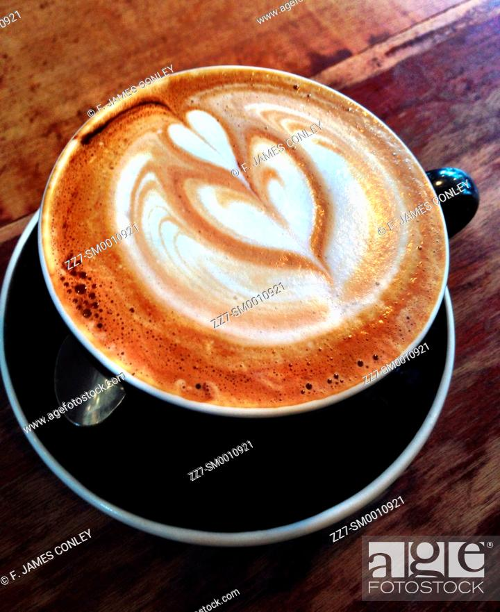 Imagen: A coffee cup decorated with foam.